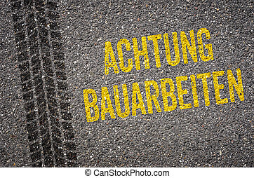 Lane with the German Translation of Caution Road work - Achtung Bauarbeiten