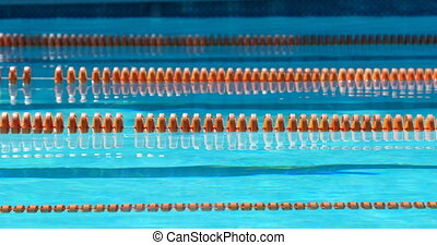Lanes of a competition swimming pool. Empty swimming pool with lane marker 4k