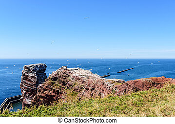 Lange Anna sea stack rock on Helgoland island against blue...