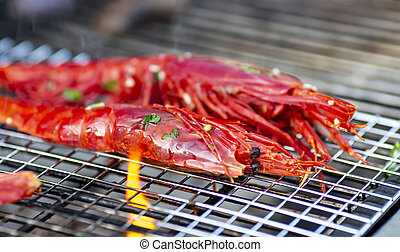 Langoustines cooking on the grill for appetizing delicious lunch or dinner