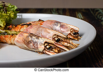 Langoustines with young potatoes. A dish with large king prawns, lobsters with vegetables. Seafood with a panel, a delicious seafood delicacy, a source of omega 3