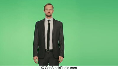 language of the body. man in suit, green background. gesture to shrug. chromakey