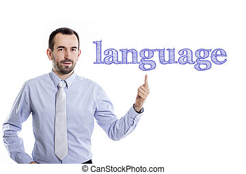 language - Young businessman with small beard pointing up in blue shirt