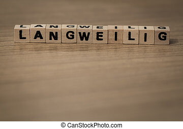 Langweilig in wooden cubes