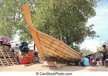 KRABI, THAILAND – MARCH 13: Shipwright building a boat by wood