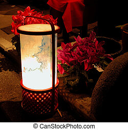 Lantern and flowers in the night