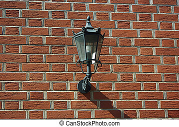 Lantern Attached To A Brick Wall