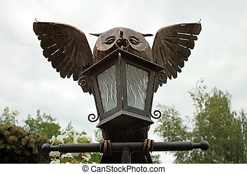 Lantern bronze owl statue in the park.