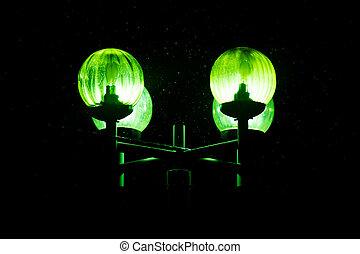 Lantern, burning green light, in the dark