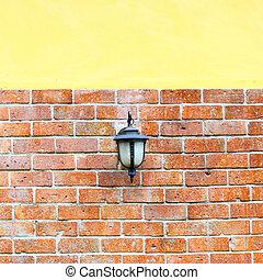lantern for light on brick wall