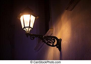 Lantern hanging a brick wall