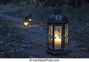Lantern in darkness - Antique lanterns on an autumn path in ...