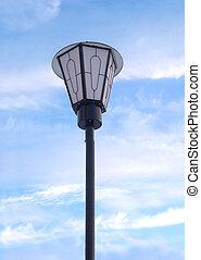 Lantern in front of blue sky
