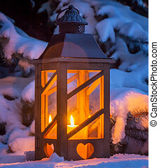 lantern in the snow at christmas
