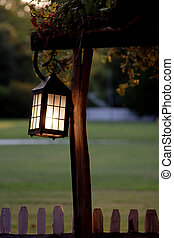 Lantern in Twilight - A lantern is hanging on a post in the...