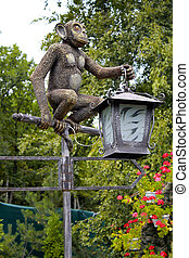 Lantern monkey statue in the park.