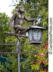 Lantern monkey statue in the park.