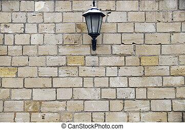 lantern on a brick wall background