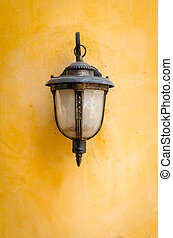 Lantern on a yellow wall