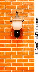 lantern on brick wall