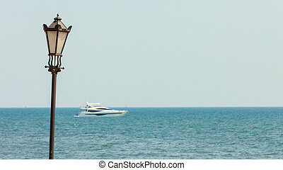 Lantern on sea ocean background with ship.