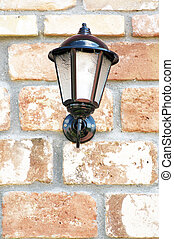 lantern on the wall of the old brick