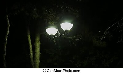 Lantern shining by night close up. - Lantern shining by...