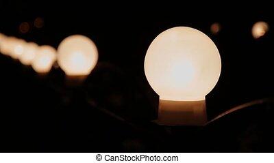 Lantern shining by night close up.