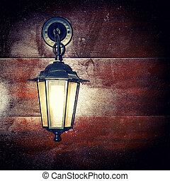lantern - Lamp lantern on a wooden background