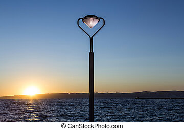 lantern with burning light at sunset at the Corniche