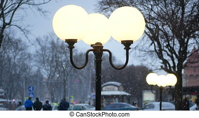 Lanterns evening snowfall - Lanterns in evening park....
