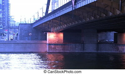 Lanterns illuminate from beneath on metal car bridge in...