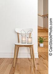 Lanterns on a white chair