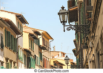 Lanterns on facades of the old houses in Florence, Italy