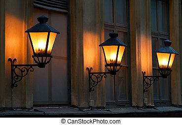 Lanterns. - Three lanterns at night.
