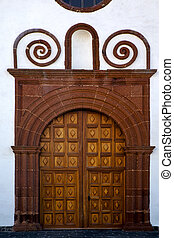 lanzarote  spain canarias brass    closed wood  church  wall abstract