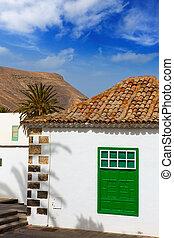 Lanzarote Yaiza white village houses green window