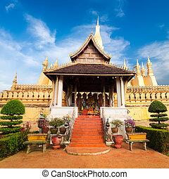 Laos travel landmark, golden pagoda wat Phra That Luang in...