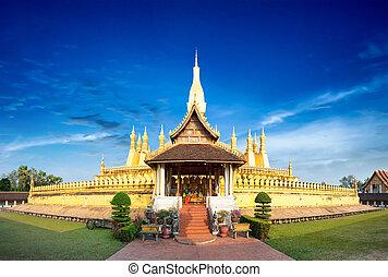 Laos travel landmark, golden pagoda wat Phra That Luang