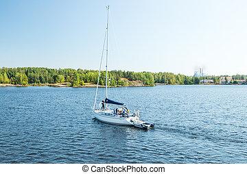 Lappeenranta, Finland - August 7, 2019: Yacht on the lake Saimaa on a sunny summer day