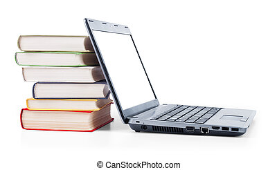 laptop and a stack of old books on white background