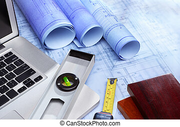 Laptop and blueprint