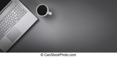 laptop and coffee cup on gray background with copy space. top view