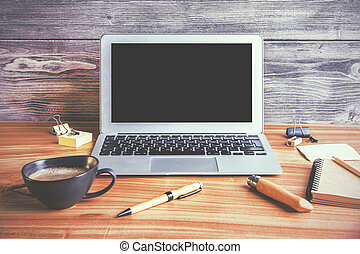 Laptop and coffee - Front view of desktop with blank laptop,...