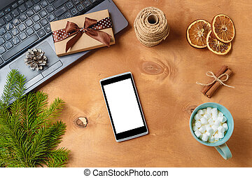 laptop and phone with empty screen for christmas seasonal advertising