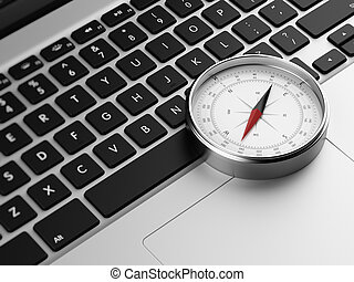 laptop and retro compass