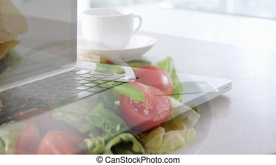 Laptop and salad in blur background - Animation of a laptop ...