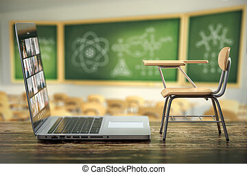 Laptop and school desk on blackdesk in classroom.  Online education and e-learning concept. Home quarantine distance learning.