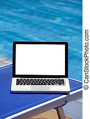 Laptop by swimming pool