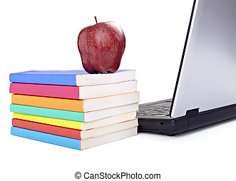 close up of stack of colorful books, apple and laptop on white background, with clipping path included